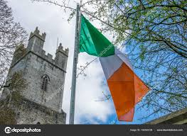 irish flag in front of the st mary cathedral u2014 stock photo