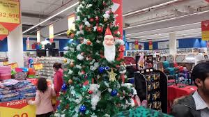 tree is beautifully decorated in packages mall with santa