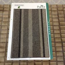 linden is a wide striped carpet from the purity collection