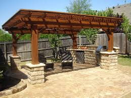 outdoor kitchen design ideas outdoor kitchen designs uk with wooden pergola and brown chairs