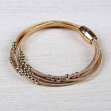bracelet string images Shop mad style gold lagos layered harp string bracelet rose gold jpg
