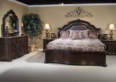 liberty furniture bedroom set leather bed with satin coverlet and decorative pillows tuscan old