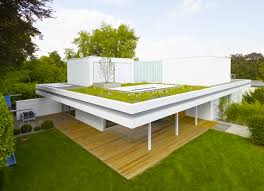 green architecture house plans 3 rooms 3 trees and a meadow adorn the roof of house s in germany