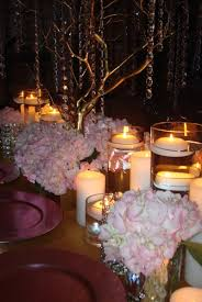 centerpiece rentals floral or feather centerpieces for sweet 16s mitzvahs weddings