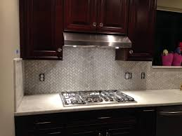 stainless steel backsplash with dark cabinets gas cooktop modern