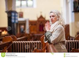young woman praying in a church royalty free stock image image
