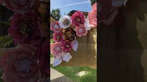 rose gold candy table pink gold and white babyshower candy table paper flowers backdrop