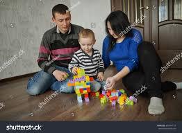 happy family play cubes home stock photo 307364132