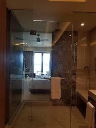 See through shower room ocean Sliding shower doors can add