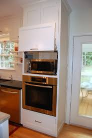 hidden microwave above wall oven unit kitchen design by leslie