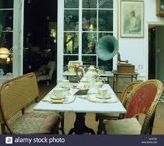 wicker chairs and marble table in dining room at night with open