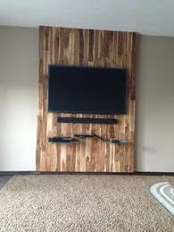 reclaimed wood feature wall and custom branded lightbox interiors