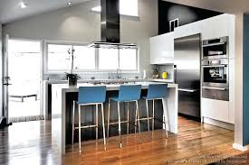 distressed white kitchen island white kitchen bar stools blue bar stools provide a pop of color in