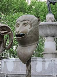 circle of friends zodiac heads in central park