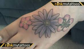 beautiful aster flower tattoo design on foot tattoomagz