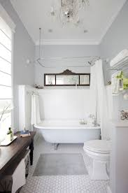 chic bathroom with clawfoot tub and neutral walls also wainscoting