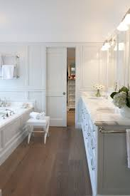white master bathroom with wood flooring and carrara marble