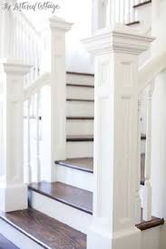 Banister And Spindles Dark Hard Wood Floors And Dark Stair Posts With White Spindles
