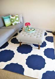 geometric rug ideas for kids room under tufted coffee table and
