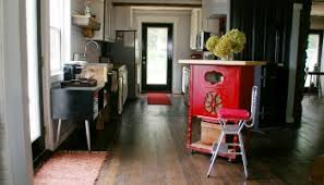 red kitchen island built out of an old radio stand with castors