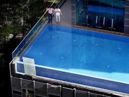 loud shattering sound as condo pool u0027s glass panels crash down