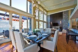 dinning rooms high ceiling dining room with black dining table