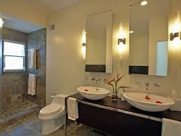 pair of wall sconces lighting fixture between mirror cabinet