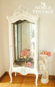shabby white curio cabinet and my best source for faux roses