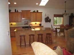 kitchen with an island also white granite countertop also panel