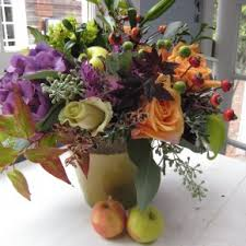 christmas table flower arrangement ideas glamorous colorful flowers with chic ceramic vase and two apples at