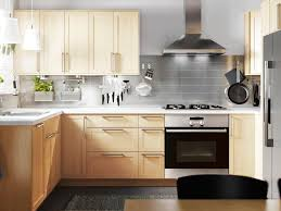 wood cabinets kitchen light contemporary gray kitchen with light wood cabinetry hgtv