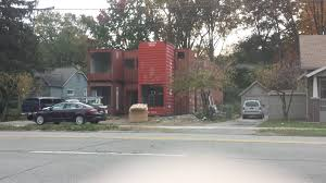 a house being made from old shipping containers pics