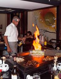 japanese restaurant cook at table hibachi stock photos and pictures getty images