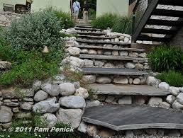 bluestone or slate steps with round stone risers gardens on