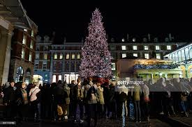 black friday christmas tree london lights up for christmas photos and images getty images