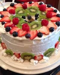 angel food cake with cream cheese frosting and strawberries food