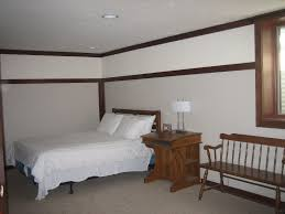 cool finished basement bedroom ideas with rattan chair also black