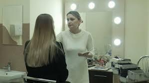 Professional Makeup Artist Lighting Professional Makeup Artist Talking And Applying Makeup Powder On A
