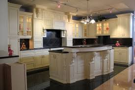 antique white kitchen cabinets with stainless steel appliances