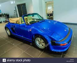 blue porsche convertible porsche 911 turbo cabriolet flatnose blue front 3 4 view stock