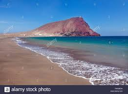 Montana beaches images La montana roja rock and playa de la tejita beach el medano stock jpg