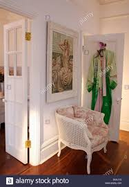 bergere home interiors picture on wall above white bergere chair with toile de jouy