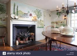 dining room with wall mural of trees and countryside in folk art dining room with wall mural of trees and countryside in folk art style fireplace containing