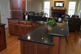 Laminate Flooring With Dark Cabinets Brown Varnished Wooden Kitchen Cabinets With Black Glossy