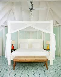 15 covet worthy canopy beds brit co headboard worthy trying to figure out how to use an adored piece of fabric grab some curtain rods and replace your headboard with it via design sponge