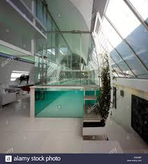 steps up custom made glass swimming pool in paxton house
