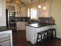Kitchens With White Cabinets And Black Countertops by Thompson Kitchen White Cabinets With Absolute Black Leather