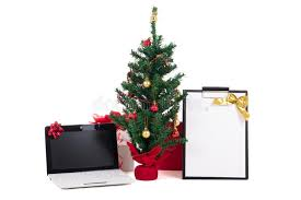 decorated christmas tree computer and gift list on white backgr