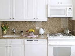 granite backsplash with white cabinets simple efficient kitchen