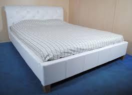 espresso leather tufted upholstsred bed frame with black wooden